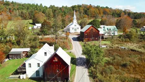 An-aerial-over-a-charming-small-village-scene-in-Vermont-with-church-road-and-farm