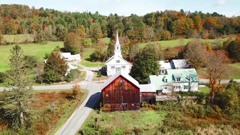 An-aerial-over-a-charming-small-village-scene-in-Vermont-with-church-road-and-farm-1