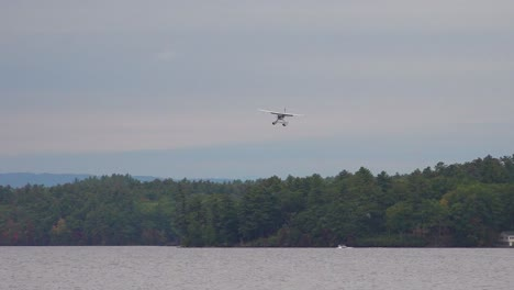A-seaplane-lands-on-a-lake-in-Maine