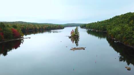 A-beautiful-aerial-over-an-island-in-the-middle-of-a-lake-in-Maine-New-Hampshire-or-Vermont