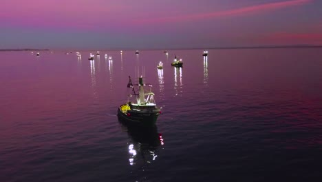 Aerial-of-squid-fishermen-with-fishing-boats-lit-by-bright-spotlights-off-the-coast-of-Malibu-California-2