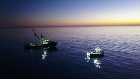 Aerial-of-squid-fishermen-with-fishing-boats-lit-by-bright-spotlights-off-the-coast-of-Malibu-California-5