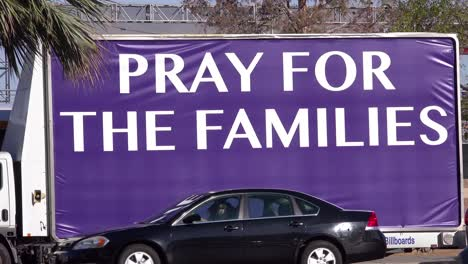 2017---a-sign-says-pray-for-the-failies-outside-the-Route-91-music-festival-site-of-America\-s-worst-mass-shooting