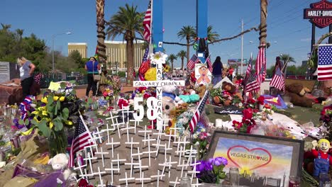 2017---thousands-of-candles-and-signs-form-a-makeshift-memorial-at-the-base-of-the-Welcome-to-Las-Vegas-sign-following-Americas-worst-mass-shooting-2