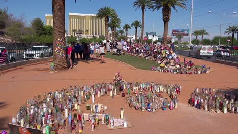 2017---thousands-of-candles-and-signs-form-a-makeshift-memorial-at-the-base-of-the-Welcome-to-Las-Vegas-sign-following-Americas-worst-mass-shooting-4