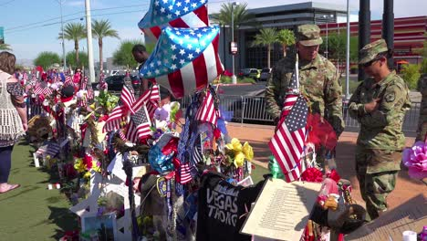 2017---thousands-of-candles-and-signs-form-a-makeshift-memorial-at-the-base-of-the-Welcome-to-Las-Vegas-sign-following-Americas-worst-mass-shooting-6