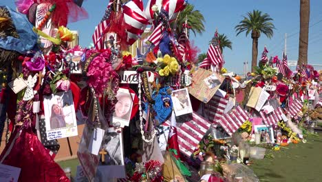 2017---thousands-of-candles-and-signs-form-a-makeshift-memorial-at-the-base-of-the-Welcome-to-Las-Vegas-sign-following-Americas-worst-mass-shooting-8