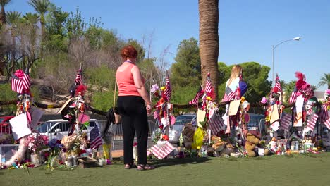 2017---thousands-of-candles-and-signs-form-a-makeshift-memorial-at-the-base-of-the-Welcome-to-Las-Vegas-sign-following-Americas-worst-mass-shooting-12