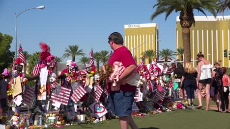 2017---thousands-of-candles-and-signs-form-a-makeshift-memorial-at-the-base-of-the-Welcome-to-Las-Vegas-sign-following-Americas-worst-mass-shooting-13