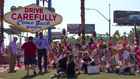 2017---thousands-of-candles-and-signs-form-a-makeshift-memorial-at-the-base-of-the-Welcome-to-Las-Vegas-sign-following-Americas-worst-mass-shooting-15