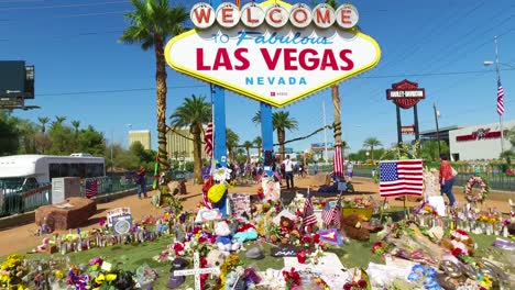 2017---thousands-of-candles-and-signs-form-a-makeshift-memorial-at-the-base-of-the-Welcome-to-Las-Vegas-sign-following-Americas-worst-mass-shooting-20