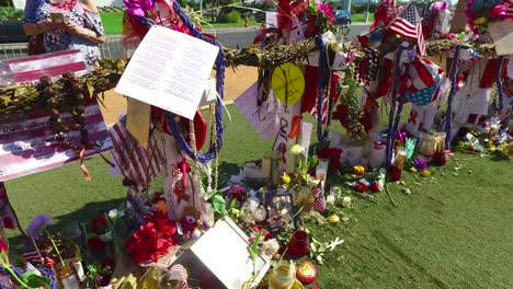 2017---thousands-of-candles-and-signs-form-a-makeshift-memorial-at-the-base-of-the-Welcome-to-Las-Vegas-sign-following-Americas-worst-mass-shooting-23