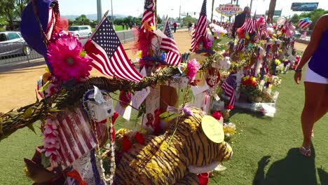 2017---thousands-of-candles-and-signs-form-a-makeshift-memorial-at-the-base-of-the-Welcome-to-Las-Vegas-sign-following-Americas-worst-mass-shooting-24