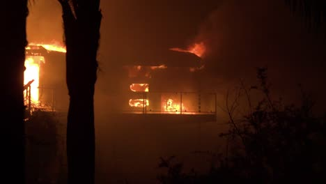 Pan-across-to-reveal-a-burning-home-at-night-during-the-2017-Thomas-fire-in-Ventura-County-California