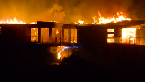 A-large-home-burns-at-night-during-the-2017-Thomas-fire-in-Ventura-County-California-1