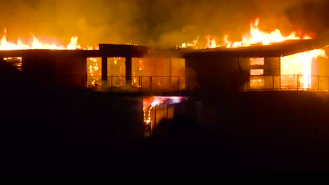 A-large-home-burns-at-night-during-the-2017-Thomas-fire-in-Ventura-County-California-2