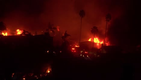 Homes-burn-all-across-hillsides-in-an-inferno-at-night-during-the-2017-Thomas-fire-in-Ventura-County-California