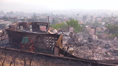 A-burned-home-smolders-on-a-hillside-following-the-2017-Thomas-fire-in-Ventura-County-California