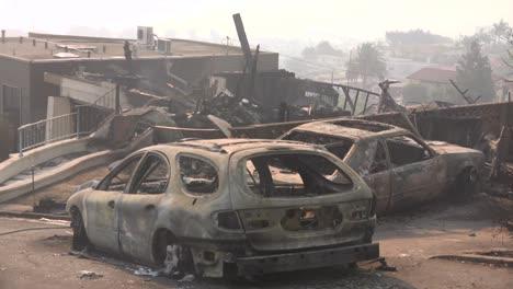 Burned-cars-smolder-on-a-hillside-street-following-the-2017-Thomas-fire-in-Ventura-County-California