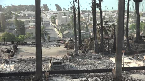 The-destroyed-remains-of-a-vast-apartment-complex-and-charred-vehicles-overlooking-the-city-of-Ventura-following-the-2017-Thomas-fire