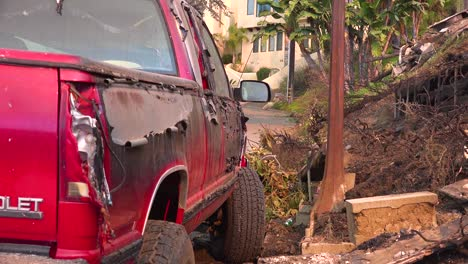 The-side-of-a-pickup-truck-is-scorched-and-melted-by-intense-heat-from-hillside-fire-following-the-2017-Thomas-fire-in-Ventura-County-California-1