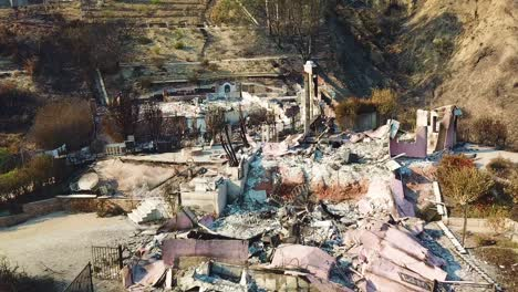 Aerial-over-a-hillside-home-destroyed-by-fire-in-Ventura-California-following-the-Thomas-wildfire-in-2017-2