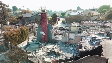 Aerial-over-a-hillside-home-destroyed-by-fire-in-Ventura-California-following-the-Thomas-wildfire-in-2017-4