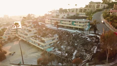 Aerial-over-a-hillside-apartment-building-destroyed-by-fire-in-Ventura-California-following-the-Thomas-wildfire-in-2017-5