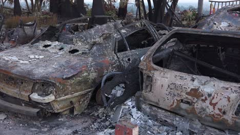Burned-cars-smolder-at-sunset-beside-a-hillside-house-following-the-2017-Thomas-fire-in-Ventura-County-California-2