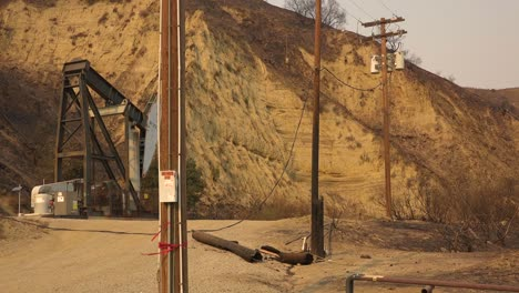A-telephone-line-is-burned-in-half-and-destroyed-causing-a-power-failure-during-the-Thomas-fire-in-Ventura-County-California