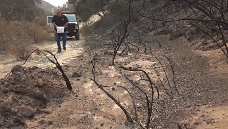 A-man-distributes-blocks-of-salt-to-help-feed-wildlife-displaced-by-the-Thomas-wildfire-in-2017