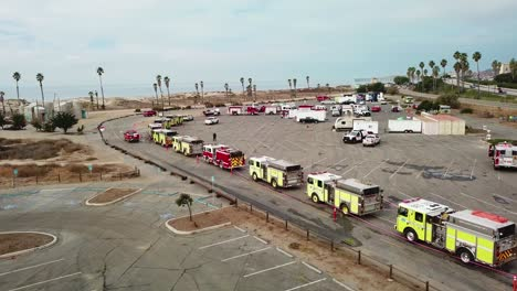 Aerial-of-firefighters-in-fire-trucks-lining-up-for-duty-at-a-staging-area-during-the-Thomas-Fire-in-Ventura-California-in-2017