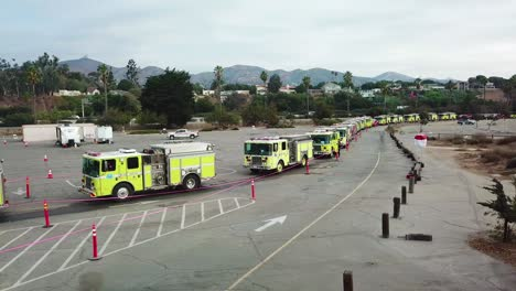 Aerial-of-firefighters-in-fire-trucks-lining-up-for-duty-at-a-staging-area-during-the-Thomas-Fire-in-Ventura-California-in-2017-1