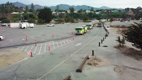 Aerial-of-firefighters-in-fire-trucks-lining-up-for-duty-at-a-staging-area-during-the-Thomas-Fire-in-Ventura-California-in-2017-2