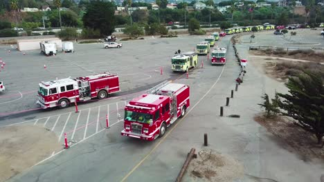 Aerial-of-firefighters-in-fire-trucks-lining-up-for-duty-at-a-staging-area-during-the-Thomas-Fire-in-Ventura-California-in-2017-3