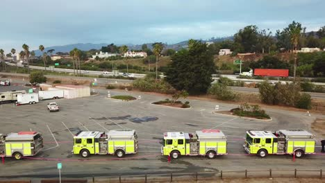 Aerial-of-firefighters-in-fire-trucks-lining-up-for-duty-at-a-staging-area-during-the-Thomas-Fire-in-Ventura-California-in-2017-4