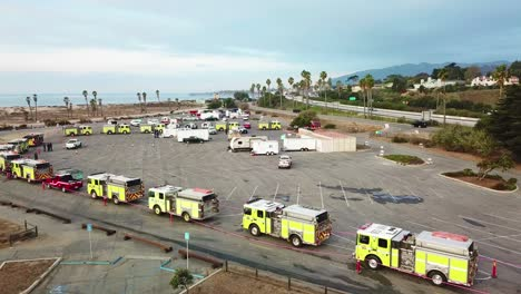 Aerial-of-firefighters-in-fire-trucks-lining-up-for-duty-at-a-staging-area-during-the-Thomas-Fire-in-Ventura-California-in-2017-5