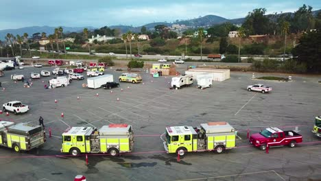 Aerial-of-firefighters-in-fire-trucks-lining-up-for-duty-at-a-staging-area-during-the-Thomas-Fire-in-Ventura-California-in-2017-6