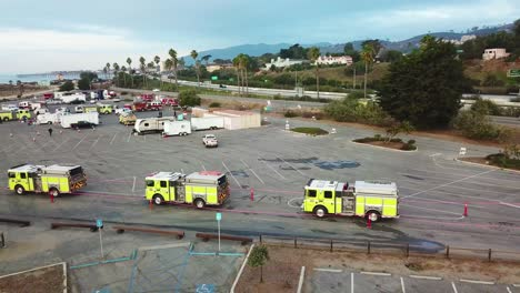 Aerial-of-firefighters-in-fire-trucks-lining-up-for-duty-at-a-staging-area-during-the-Thomas-Fire-in-Ventura-California-in-2017-7