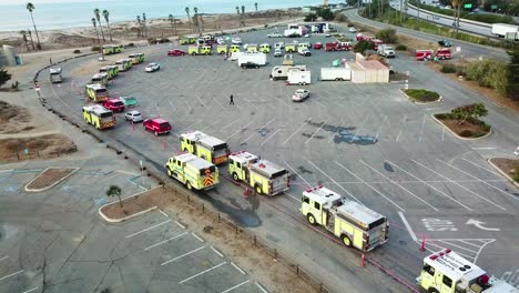 Aerial-of-firefighters-in-fire-trucks-lining-up-for-duty-at-a-staging-area-during-the-Thomas-Fire-in-Ventura-California-in-2017-8