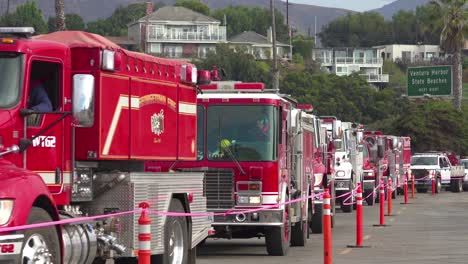 Firefighters-in-fire-trucks-lining-up-for-duty-at-a-staging-area-during-the-Thomas-Fire-in-Ventura-California-in-2017