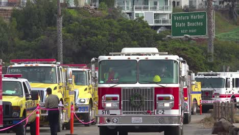 Firefighters-in-fire-trucks-lining-up-for-duty-at-a-staging-area-during-the-Thomas-Fire-in-Ventura-California-in-2017-4