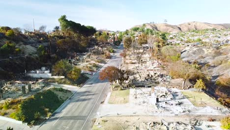 Aerial-over-entire-street-of-hillside-homes-destroyed-by-fire-in-Ventura-California-following-the-Thomas-wildfire-in-2017-6