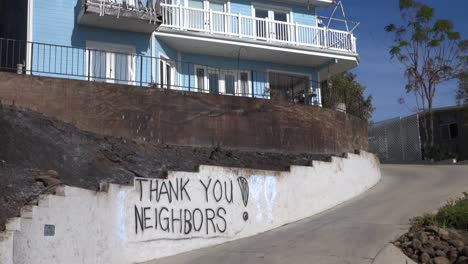 A-thank-you-to-neighbors-is-spray-painted-on-a-wall-outside-a-house-during-the-devastating-Thomas-Fire-in-Ventura-California