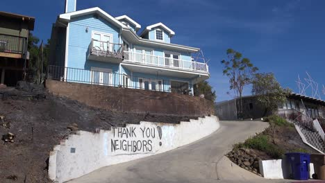 A-thank-you-to-neighbors-is-spray-painted-on-a-wall-outside-a-house-during-the-devastating-Thomas-Fire-in-Ventura-California-1