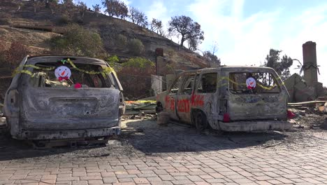2017---burned-cars-in-the-Thomas-fire-are-decorated-with-Christmas-decorations