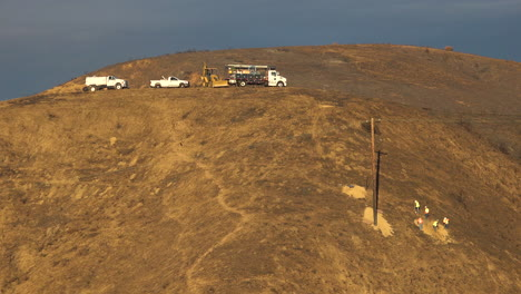 A-SCE-telephone-lineman-maintenance-crew-works-on-power-lines-on-burned-hills-following-the-disastrous-Thomas-Fire