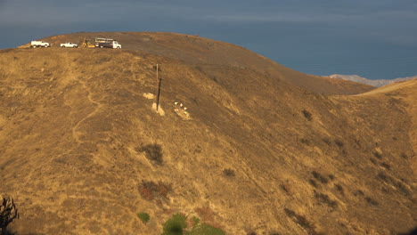 A-SCE-telephone-lineman-maintenance-crew-works-on-power-lines-on-burned-hills-following-the-disastrous-Thomas-Fire-1