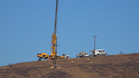 A-SCE-telephone-lineman-maintenance-crew-works-on-power-lines-on-burned-hills-following-the-disastrous-Thomas-Fire-2