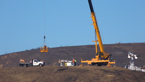A-SCE-telephone-lineman-maintenance-crew-works-on-power-lines-on-burned-hills-following-the-disastrous-Thomas-Fire-3